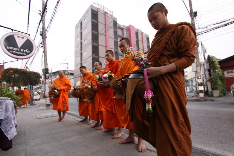 Morning offering to monks on street