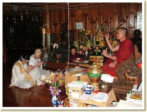 monk doing Thai wedding blessing for destination wedding couple
